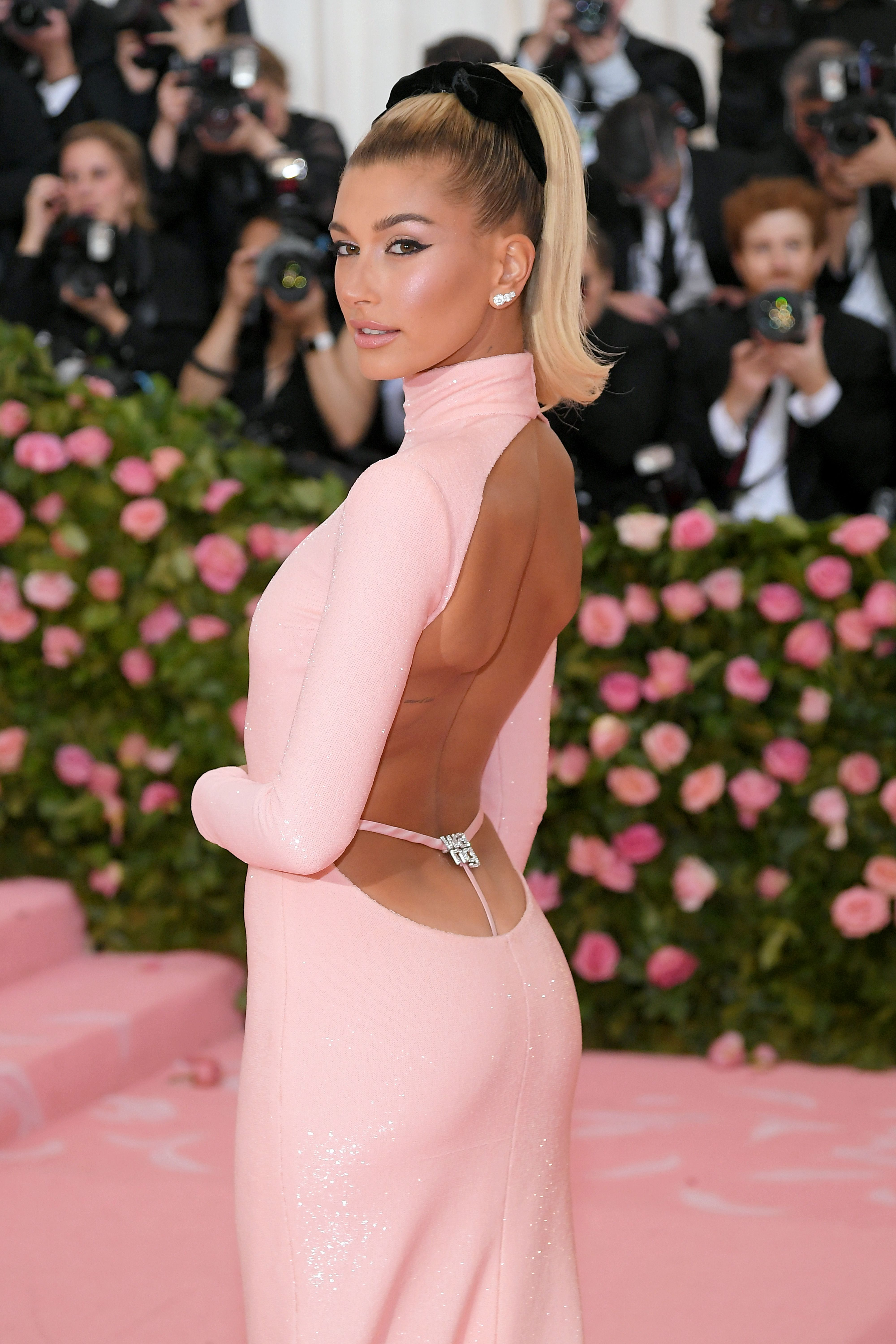 b2cfe07b0abc Hailey Baldwin Wore a Millennial Pink Gown With a Bedazzled Whale Tail Sans  Justin Bieber at the Met Gala