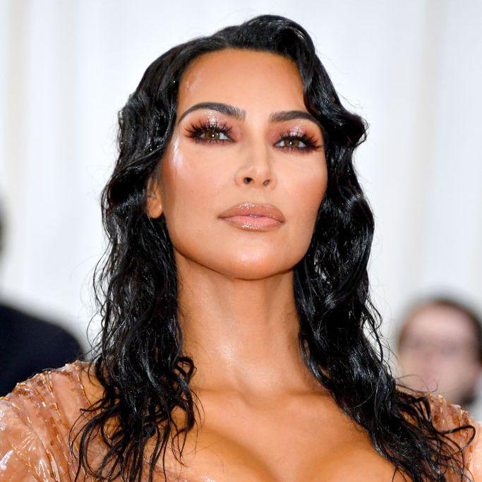 Kim Kardashian Kardashian wore brown contacts and a soft glam, glittery bronze shadow look.
