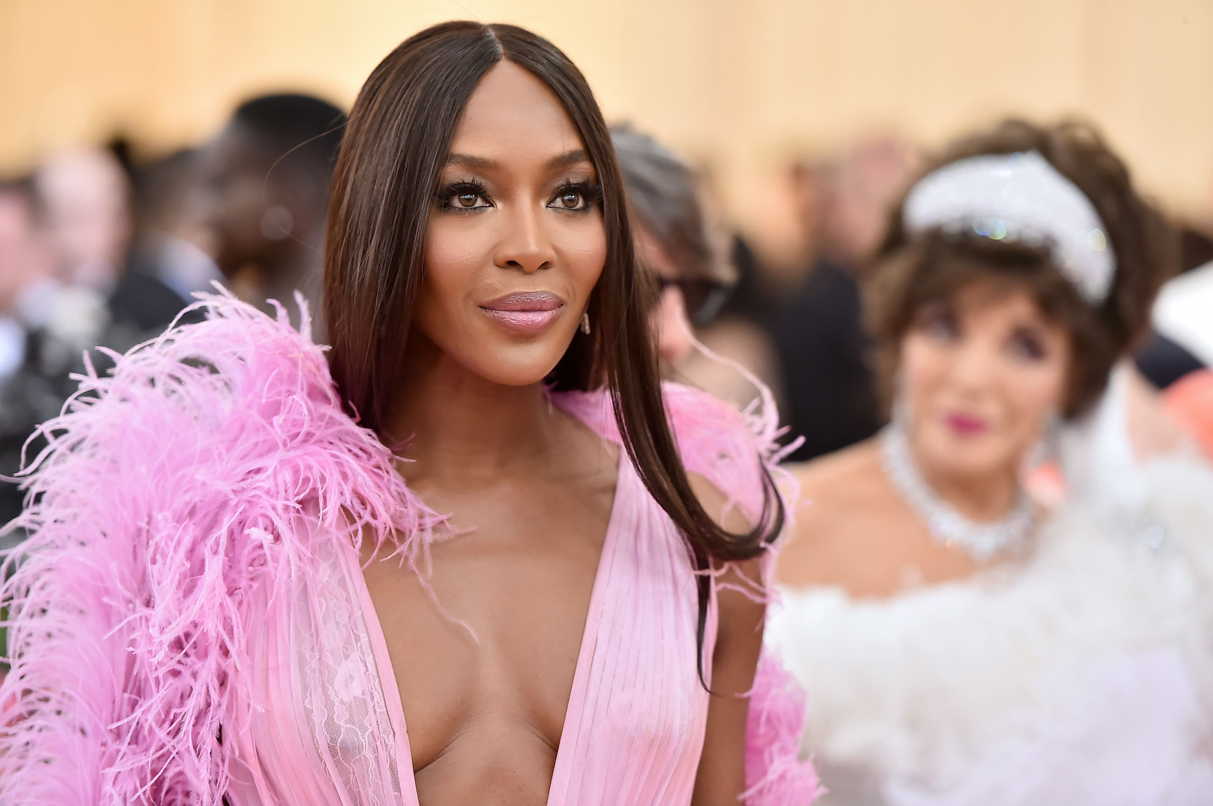 Naomi Campbell The supermodel might've worn a head-turning dress, but her glam for the night was classically glamorous: center parted long hair, pink lips, and smoky eyes.