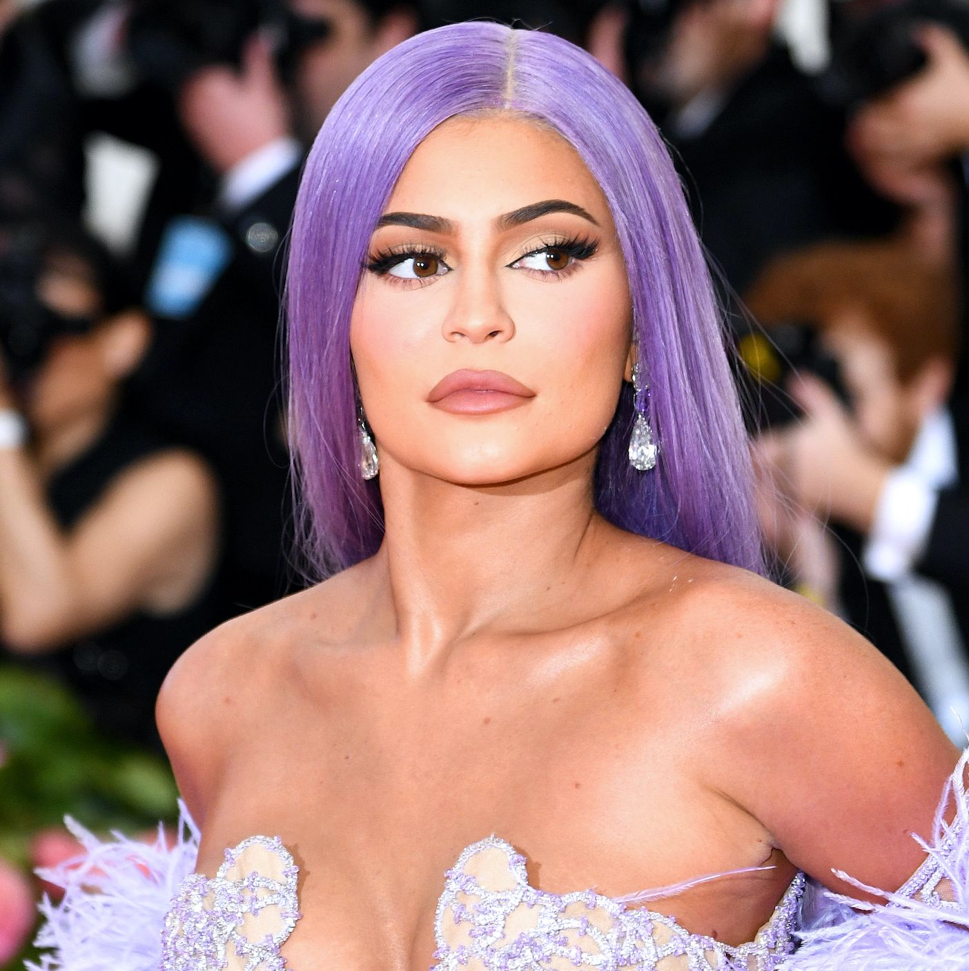 Kylie Jenner A huge fan of wigs, Jenner debuted a straight purple 'do to match her lavender ensemble. Her face beat was classic glam, with her signature matte brown-nude lip.