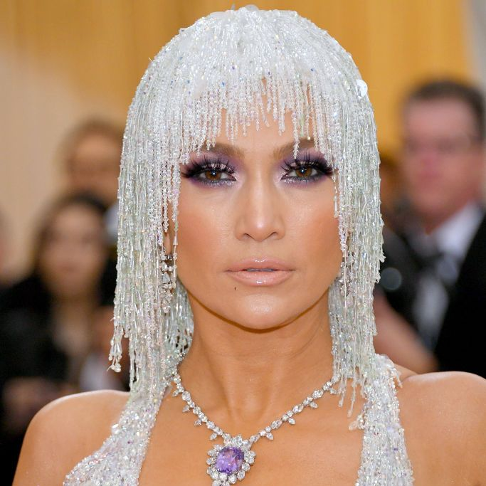 Jennifer Lopez Lopez's beauty look was all about the eyes: dramatic purple eyeshadow and piece-y lashes. Her cheeks were chiseled and contoured while her lips were a perfect flesh-toned gloss.