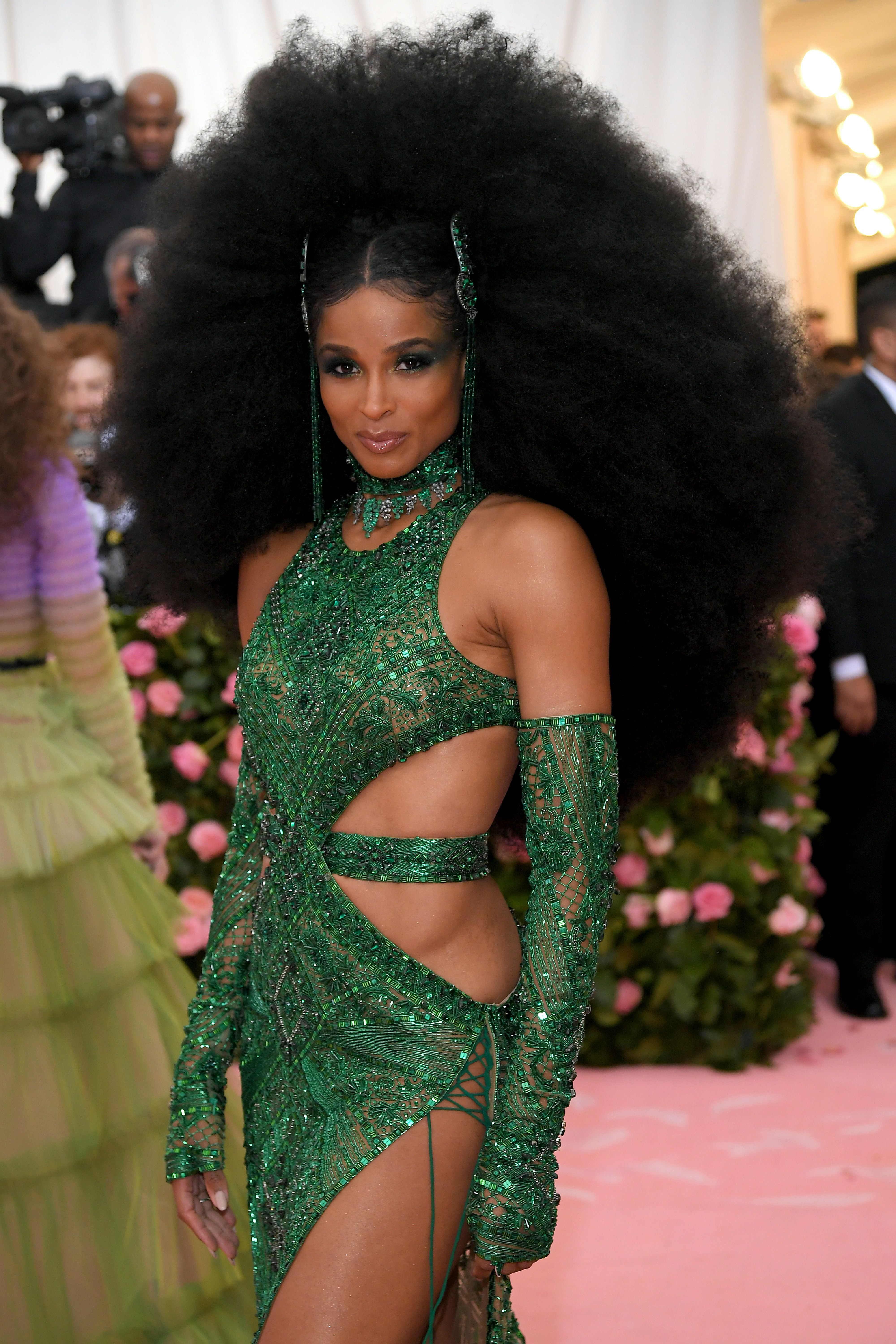 Ciara Ciara wore an extra, extra big afro with emerald tasseled hair accessories creating a center part. Her eye makeup was also emerald, applied deliberately imperfectly across her lids all the way to her temples.