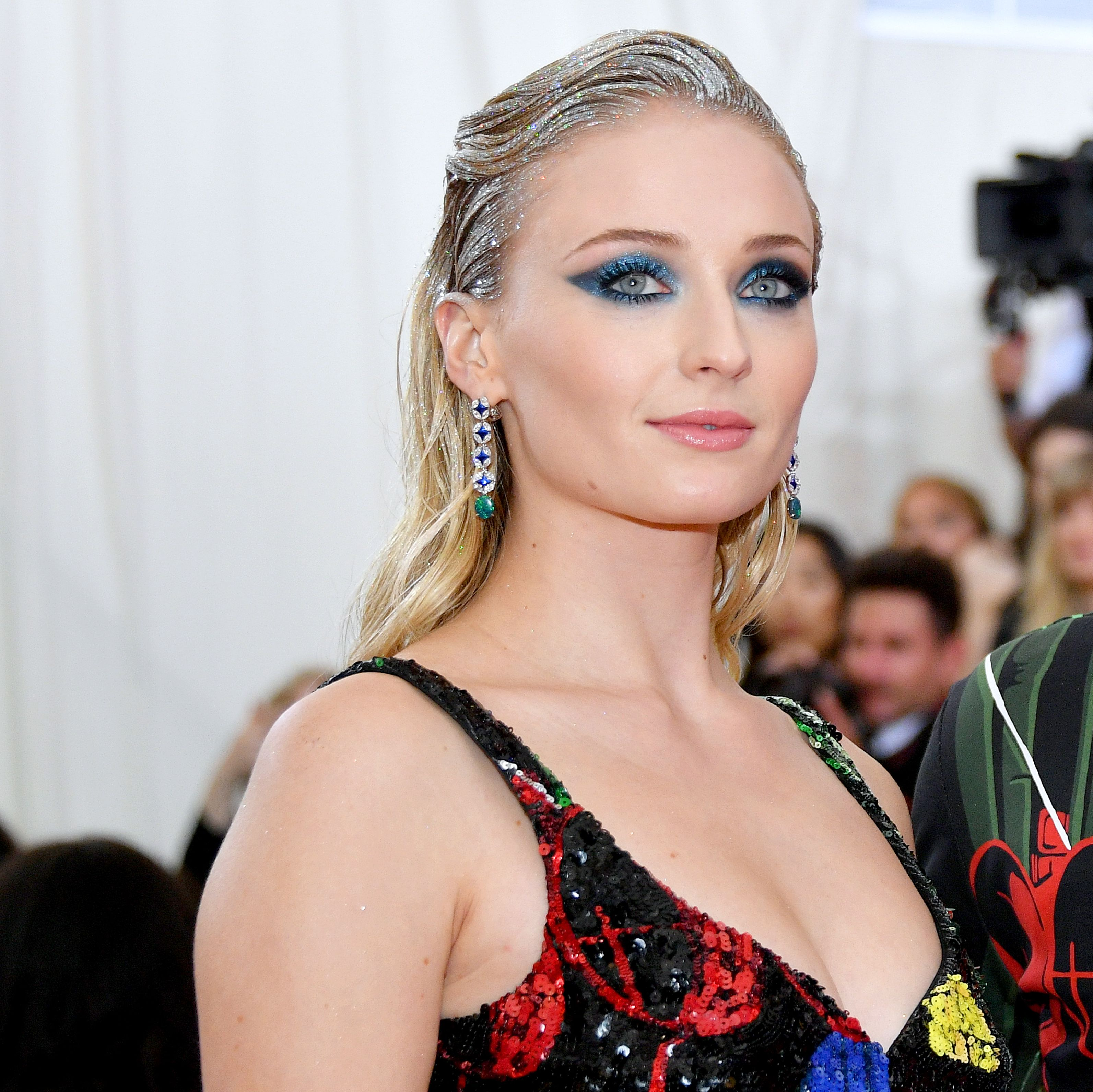 Sophie Turner The Game of Thrones star wore streaks of silver glitter in her hair. The metallic theme continued with a winged blue smoky eye.