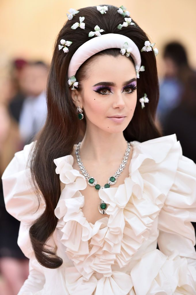 """Lily Collins Lily Collins looks like she just walked out of a storybook with her lavender-dusted lids and thick headband. """"I was inspired by Lily's Giambattista Valli Couture gown so I wanted to create a Sharon Tate wedding look/Priscilla Presley hairdo,"""" hairstylist Gregory Russell explains."""