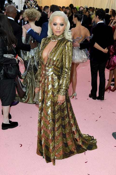 Clothing, Fashion, Carpet, Red carpet, Hairstyle, Flooring, Event, Fashion design, Dress, Haute couture,