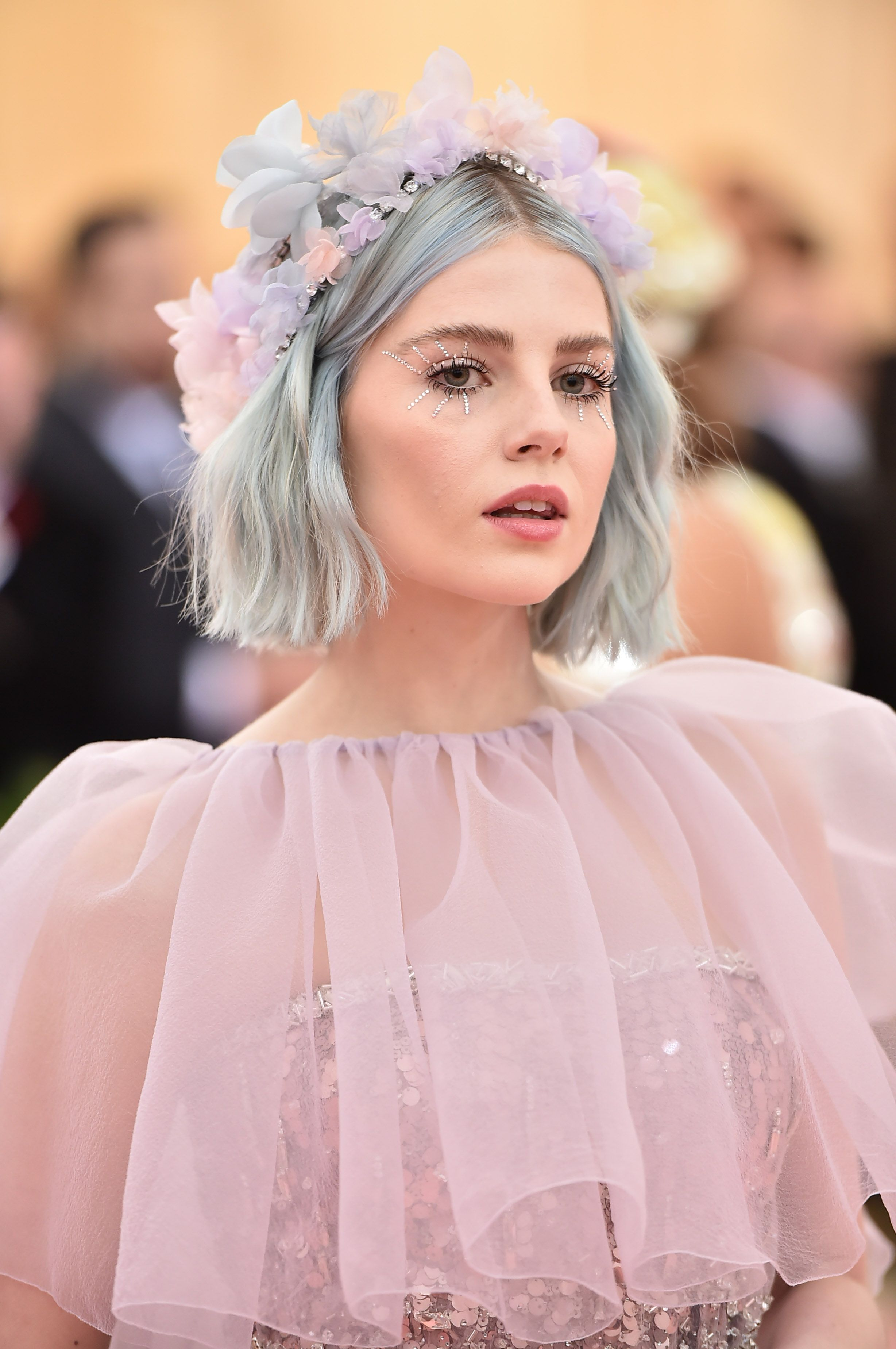 Lucy Boynton Lucy Boynton is a true beauty, and can pull any look off flawlessly. I hope this is not the end of her mermaid pastel blue hair she debuted on the red carpet.