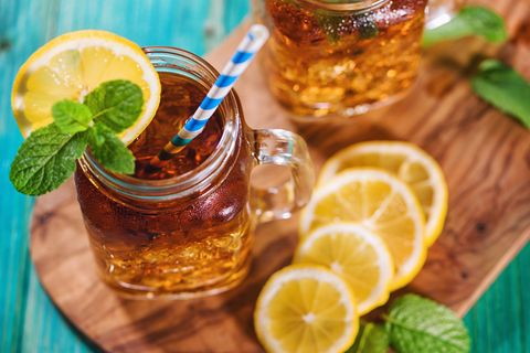 freshly made ice tea with lemon and mint in a jar