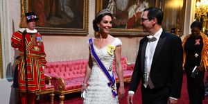 Kate Middletonand United States Secretary of the Treasury, Steven Mnuchin arrive through the East Gallery for a State Banquet at Buckingham Palace on June 3, 2019 in London, England.