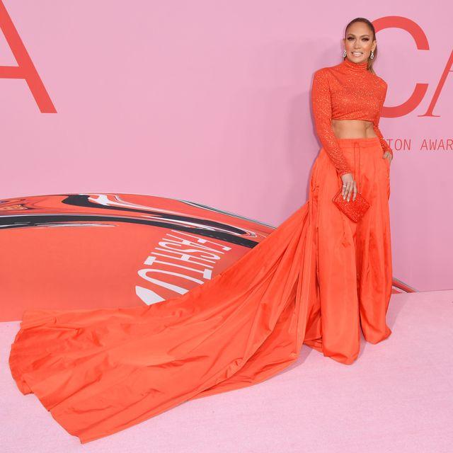 Orange, Clothing, Dress, Red, Shoulder, Peach, Fashion model, Fashion, Pink, Gown,