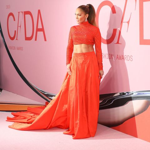 Red carpet, Clothing, Dress, Red, Shoulder, Carpet, Pink, Orange, Fashion, Fashion model,