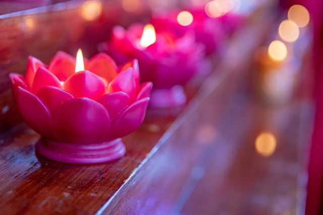 candles burning as a sign of respect at the buddhas birth day ceremony