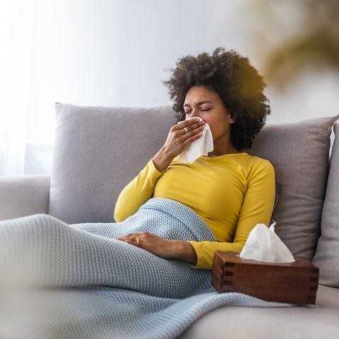 Woman with flu symptoms resting.