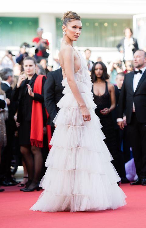 Gown, Dress, Red carpet, Clothing, Carpet, Shoulder, Flooring, Premiere, Haute couture, Fashion,
