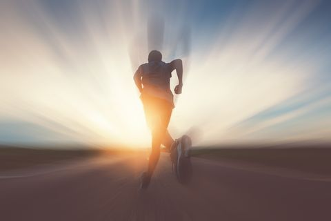 Man Running On Road Against Sky During Sunset