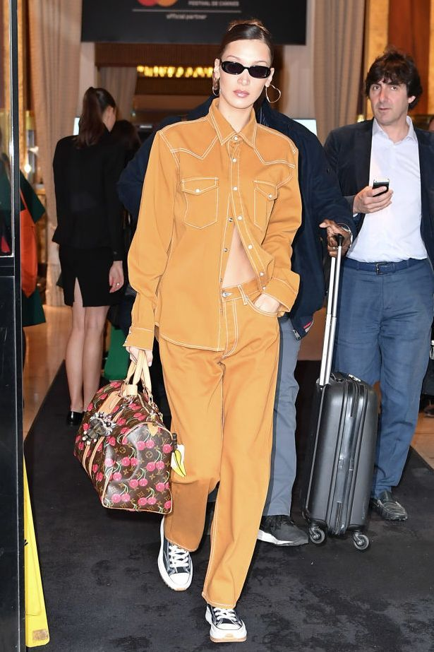 Who: Bella Hadid When: May 18, 2019 Wearing: Sandro set, Louis Vuitton bag Why: Bella Hadid walked around Cannes dressed like the last boy who ghosted me, and I love it. She can leave me on read any day if her outfit is this fresh.