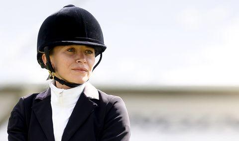 Helmet, Equestrian helmet, Personal protective equipment, Hat, Headgear, Suit, Fashion accessory, Photography, Recreation, Formal wear,