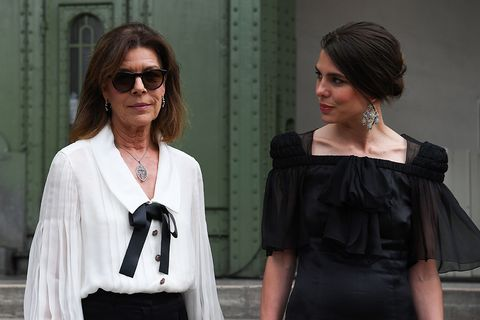 Shoulder, Eyewear, Street fashion, Fashion, Black-and-white, Fashion design, Sunglasses, Joint, Dress, Little black dress,