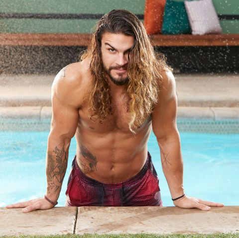 Barechested, Hair, Chest, Muscle, Leisure, Long hair, Swimming pool, Sitting, Abdomen, Photography,