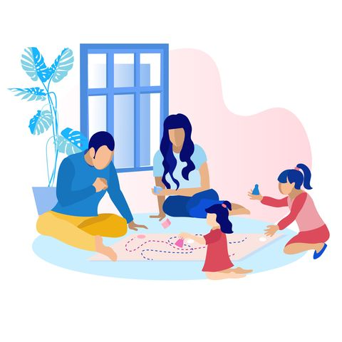 Happy Parents with Children Playing Game at Home