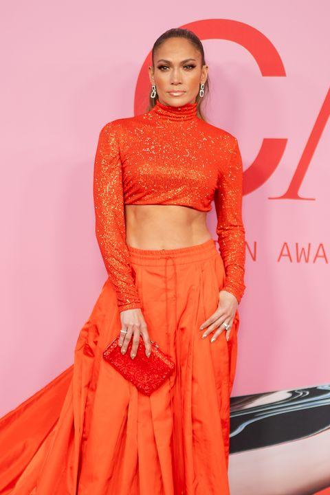 Clothing, Orange, Red, Peach, Fashion, Fashion model, Beauty, Pink, Crop top, Dress,