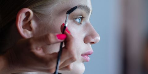 03 july 2019, berlin a make up stylist takes care of the eyebrows of a model for the show of designer marcel ostertag the collections for springsummer 2020 will be presented at berlin fashion week photo lisa ducretdpa photo by lisa ducretpicture alliance via getty images