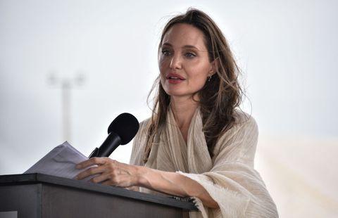 Public speaking, Shoulder, Orator, Spokesperson, Speech, Sitting, Businessperson, White-collar worker, Employment, Long hair,