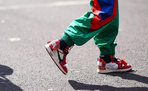 Red, Footwear, Shoe, Asphalt, Leg, Carmine, Human leg, Recreation, Sports equipment, Athletic shoe,