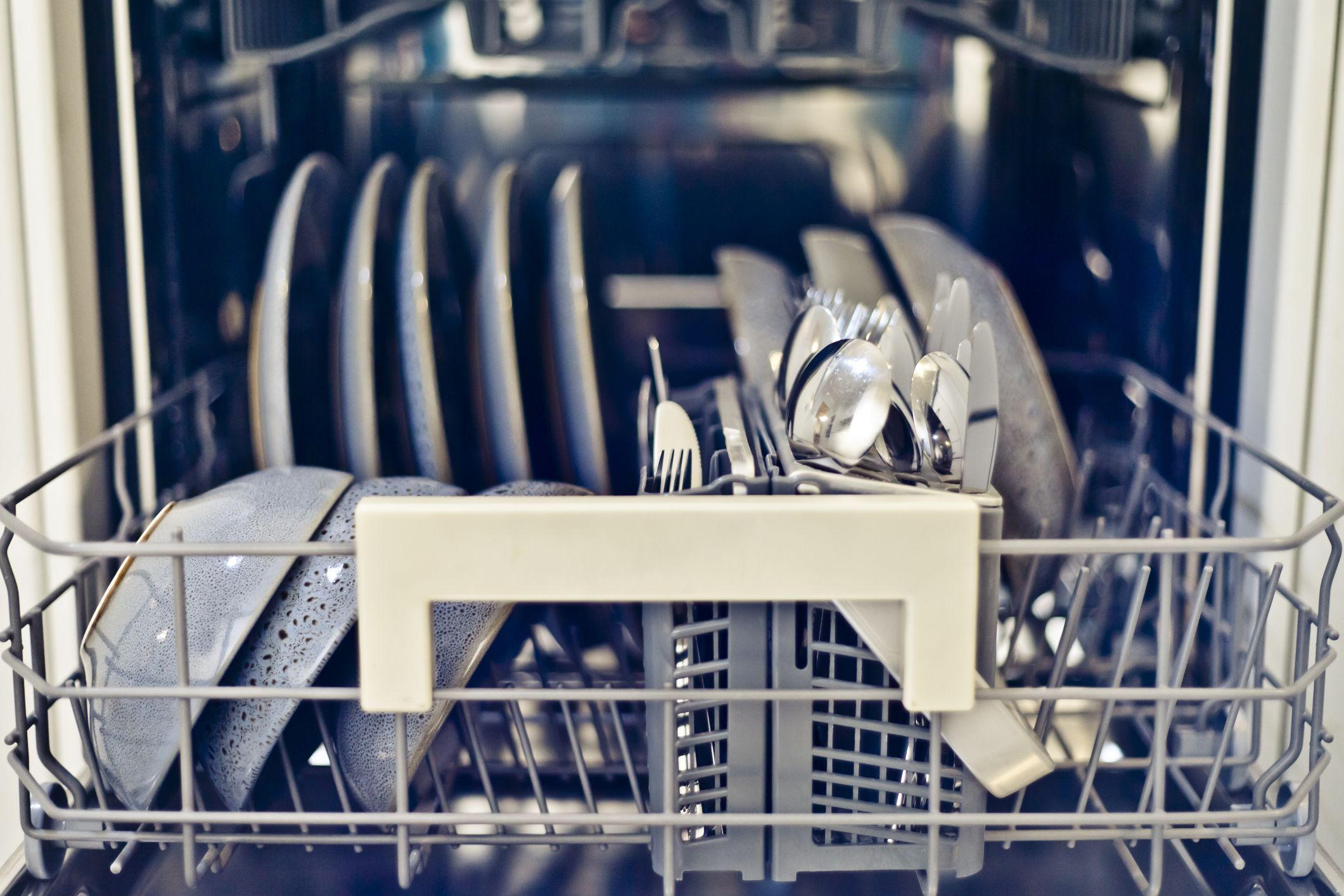 Expert reveals the correct way to load your dishwasher cutlery: should it point up or down?