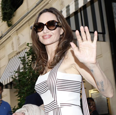 dc51c37088d Angelina Jolie Steps Out In Loro Piana Striped Maxi Dress On Paris ...