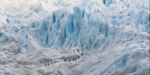 Group of people hiking on the Perito Moreno glacier, Argentina