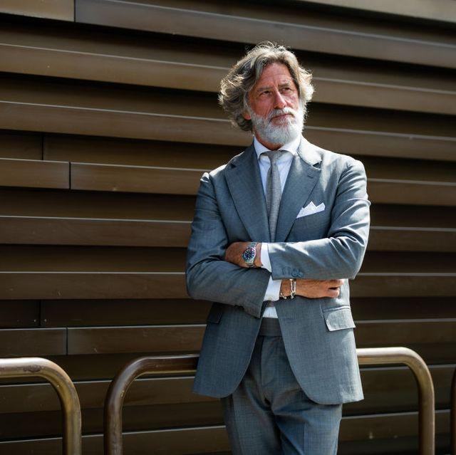 Standing, Suit, Blazer, Outerwear, White-collar worker, Formal wear,