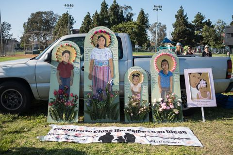 Portraits of dead immigrants during the protest.  Over one