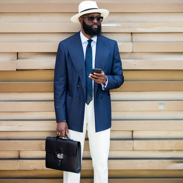 florence, italy   june 12 a guest is seen wearing navy blazer, hat during pitti immagine uomo 96 on june 12, 2019 in florence, italy photo by christian vieriggetty images