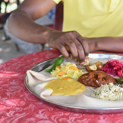 man having ethiopian food in addis ababa