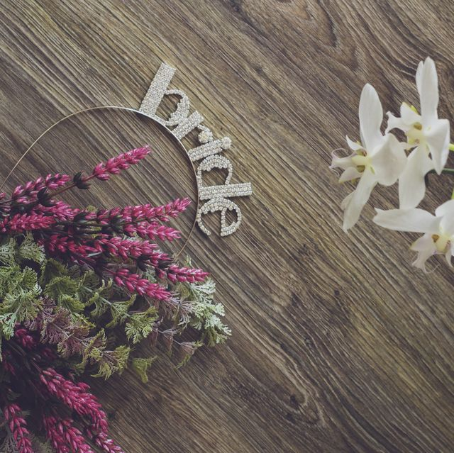 bride headband and flowers on the wooden floor