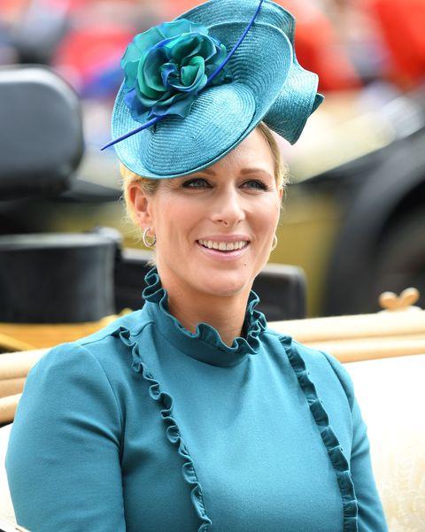 Hat, Smile, Headgear, Fashion accessory, Costume hat, Uniform, Electric blue, Tradition, Costume,