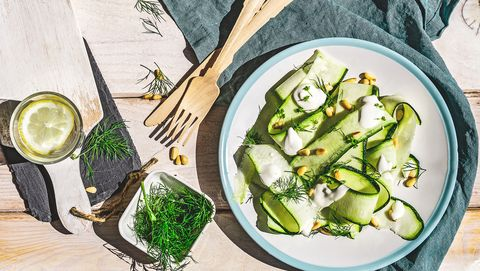 zuccini salad with sour cream, dill and pine nut