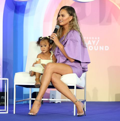 new york, new york   june 23 luna legend joins chrissy teigen  onstage during popsugar playground at pier 94 on june 23, 2019 in new york city photo by monica schippergetty images for popsugar and reed exhibitions
