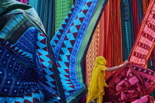 india, rajasthan, sari factory, textile are dried in the open air collecting of dry textile are folded by women
