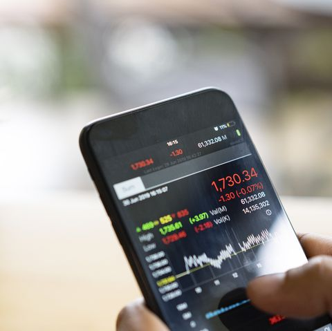 businessman using a mobile phone to check stock market data