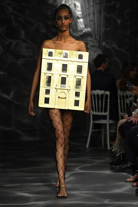 Fashion model, Fashion show, Fashion, Runway, Clothing, Shoulder, Yellow, Fashion design, Haute couture, Human,