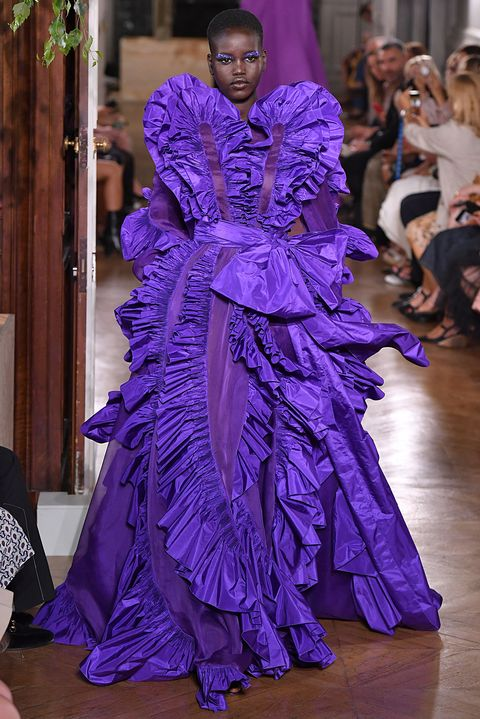 Haute couture, Fashion, Purple, Fashion model, Dress, Gown, Fashion design, Event, Shoulder, Fashion show,