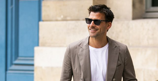 paris, france   july 01 johannes huebl, wearing a white t shirt, beige blazer, blue jeans and brown loafers, is seen outside dundas show during paris fashion week   haute couture fallwinter 20192020 on july 01, 2019 in paris, france photo by claudio laveniagetty images
