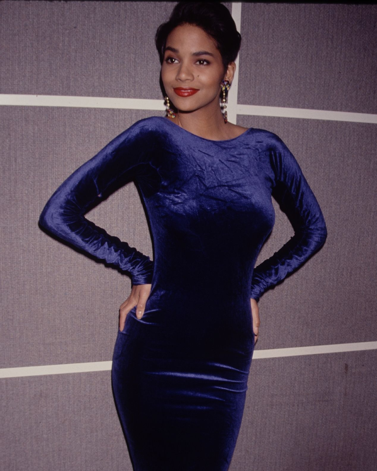 Red Carpet Beauty Halle almost looks unrecognizable in this 1990 photo! The velvet, high-neck dress shows off her curves, and the simple makeup keeps the focus on her knockout body.