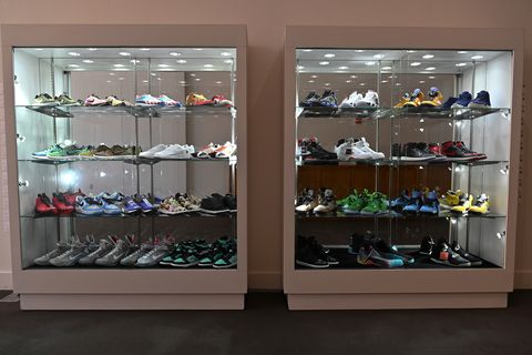 Display case, Furniture, Footwear, Shoe store, Shelf, Shoe, Room, Collection, Shoe organizer, Shelving,