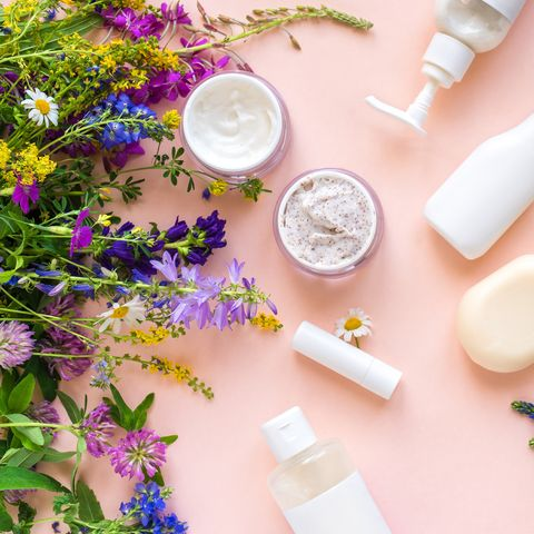 eco friendly skincare natural cosmetics and organic herbs and flowers on pink background, top view, flat lay bio research and healthy lifestyle concept