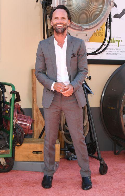 Suit, Blazer, Outerwear, Formal wear, Carpet, Flooring, Facial hair, White-collar worker,