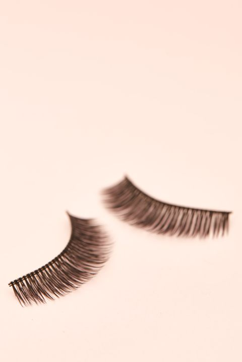 Close-Up Of False Eyelashes On Colored Background