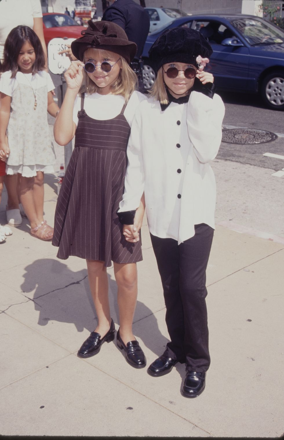 March 18, 1995 Wearing black and white ensembles with black round sunglasses.