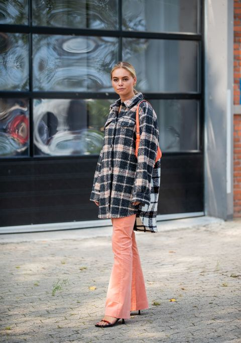 copenhagen, denmark   august 07 claire rose cliteur seen wearing plaid button up shirt, flared salmon colored pants, orange fendi bag outside munthe during copenhagen fashion week springsummer 2020 on august 07, 2019 in copenhagen, denmark photo by christian vieriggetty images